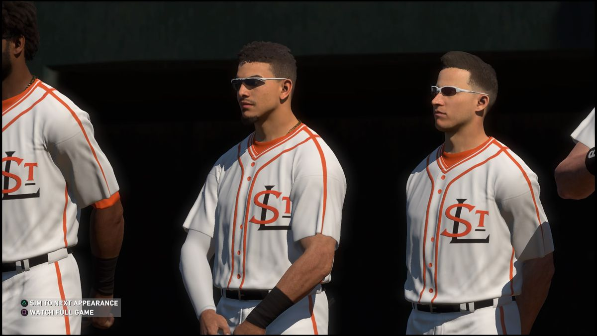 players in sunglasses, with caps off, stand for the national anthem before a baseball game