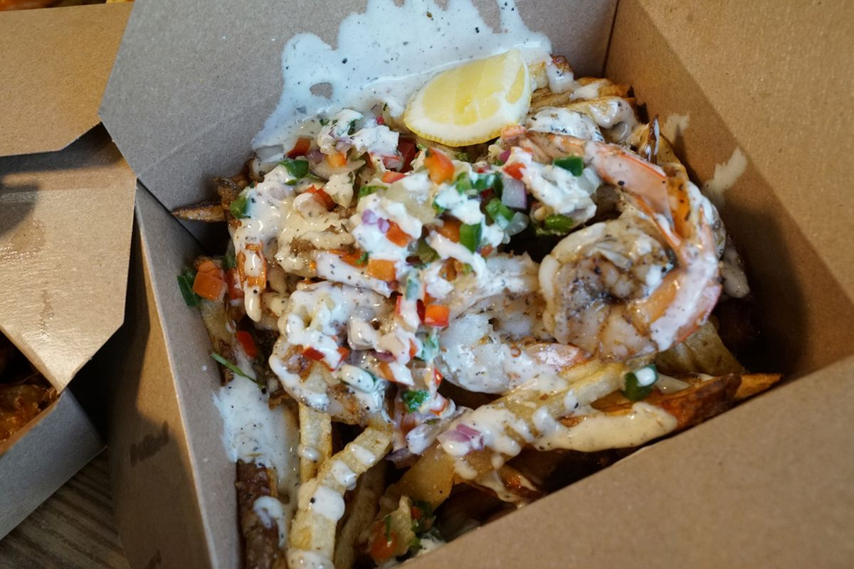 Jerk-seasoned shrimp, pineapple salsa, and pina colada crema served on a bed of fresh pomme frites, made at Friistyle.