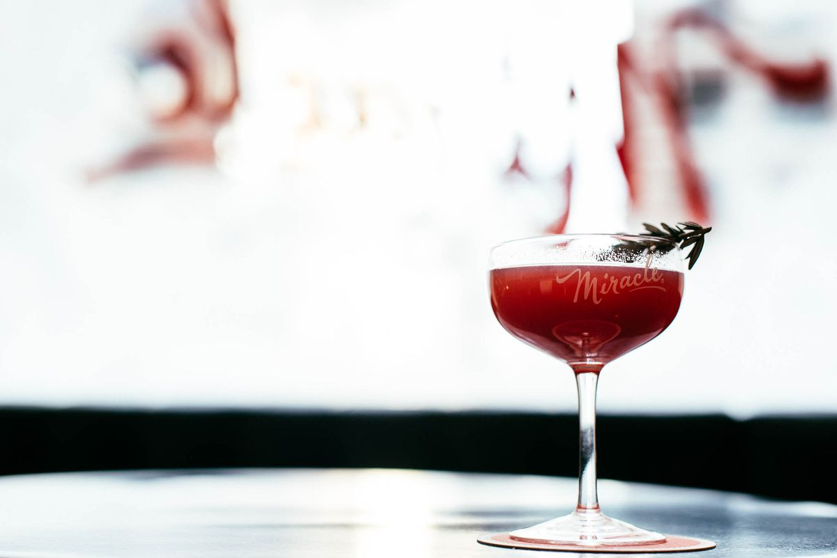 A photo of a red drink in a martini glass at the Miracle pop up bar at Avanti Food & Beverage last year