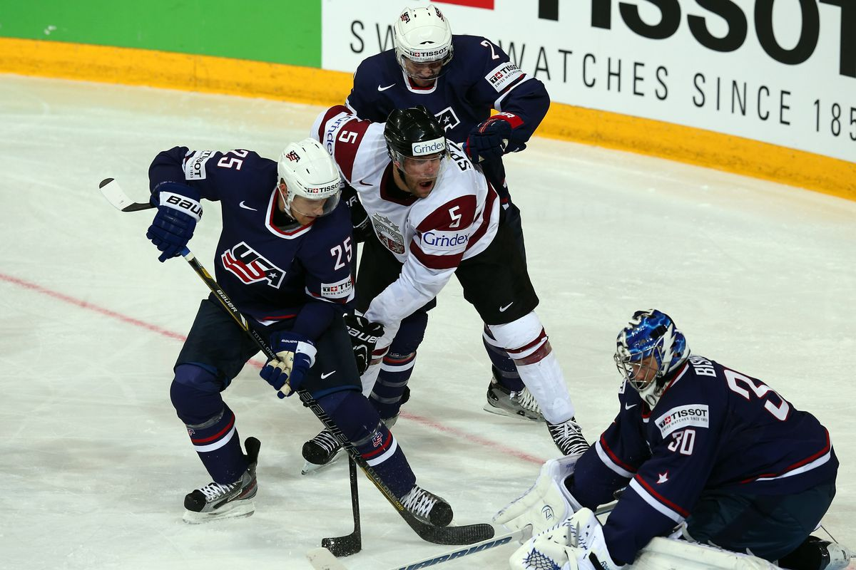 Matt Carle (25), Jeff Perty (2), and Ben Bishop (30) of USA and Janis Sprukts (C) of Latvia, May 5, 2013 in Helsinki, Finland