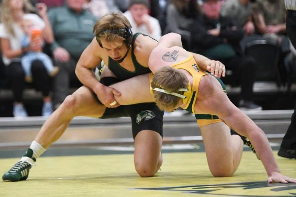 Utah Valley 174-pound sophomore Kimball Bastian (left) looks to take down North Dakota State's Colton Clingenpeel on Dec. 15. On Sunday, Bastian led the way for the Wolverines by placing second in his weight class at the Reno Tournament of Champions.
