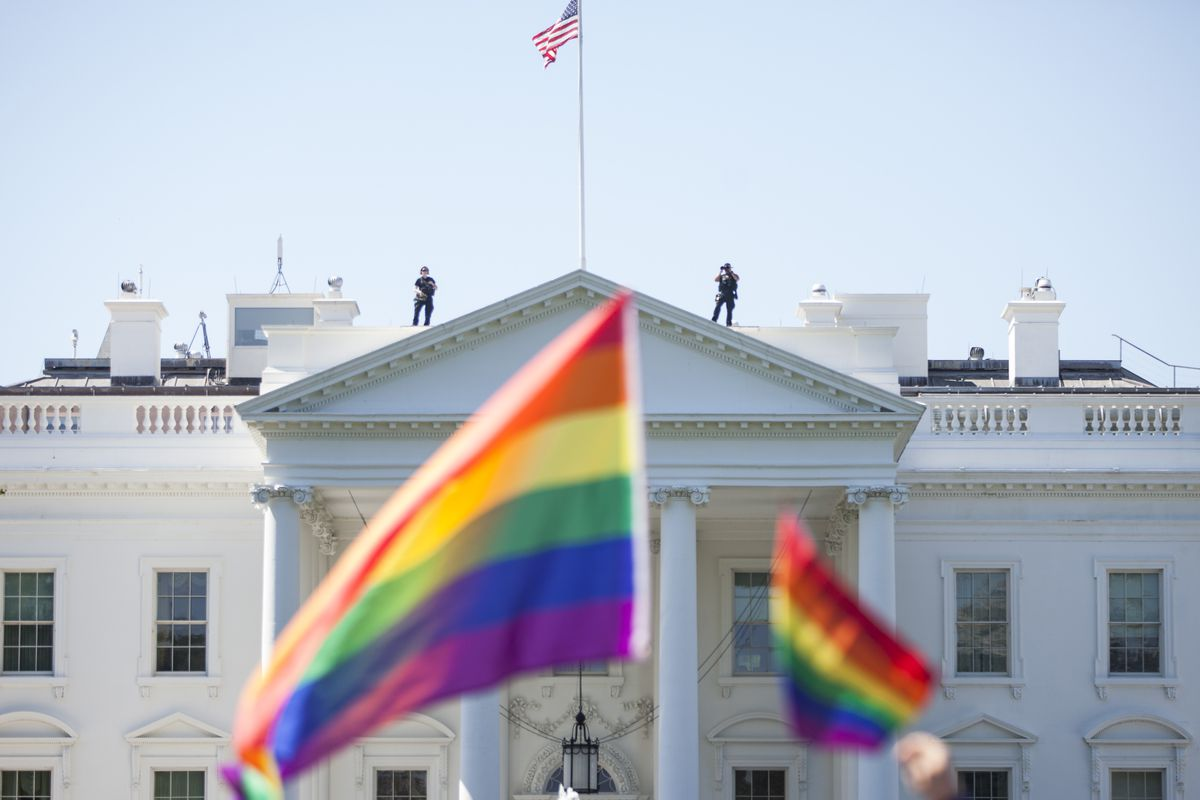 Demonstrators carry rainbow flags past the White House during the Equality March for Unity and Peace on June 11, 2017, in Washington, DC.