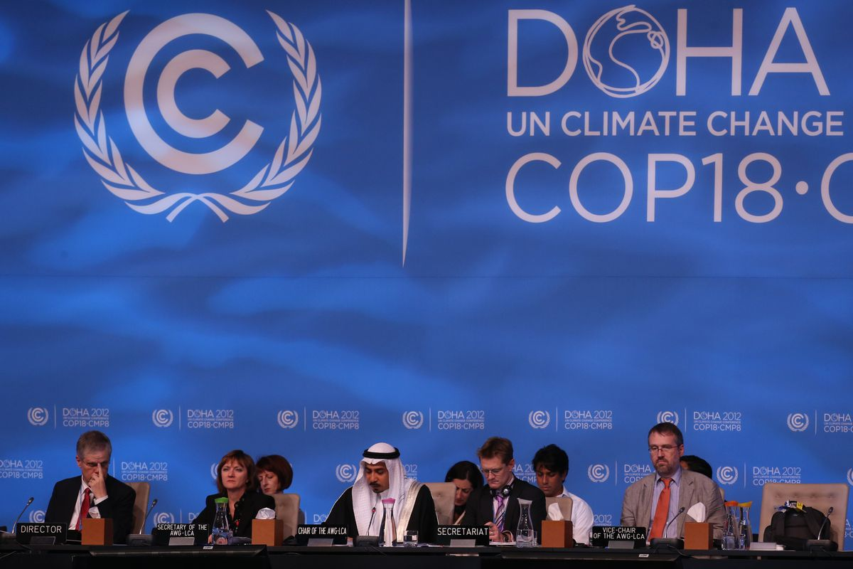Delegates attend the last day of the UN climate talks in Doha, on December 7, 2012.