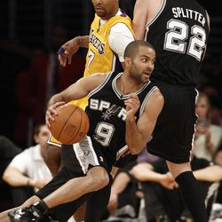 San Antonio Spurs guard Tony Parker (9) drives as teammate Tiago Splitter (22) sets a pick on Los Angeles Lakers' Ramon Sessions (7) during the first half of their NBA basketball game, Tuesday, April 17, 2012, in Los Angeles.