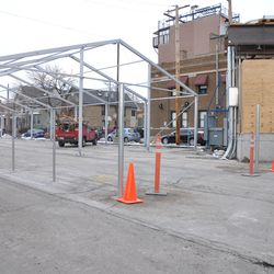 Fence poles installed in front of the VIP/Players tent parking structure -