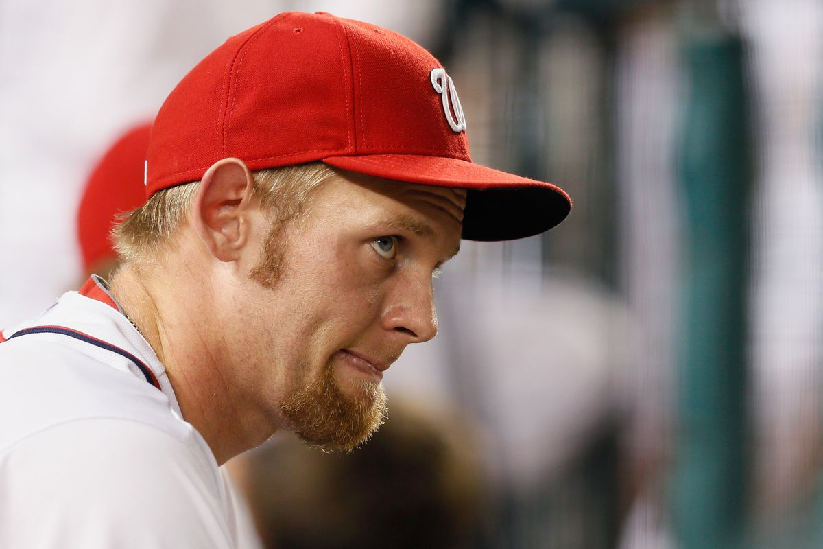 Stephen Strasburg watches, as he will for the rest of the year, from the bench.  (Photo by Rob Carr/Getty Images)