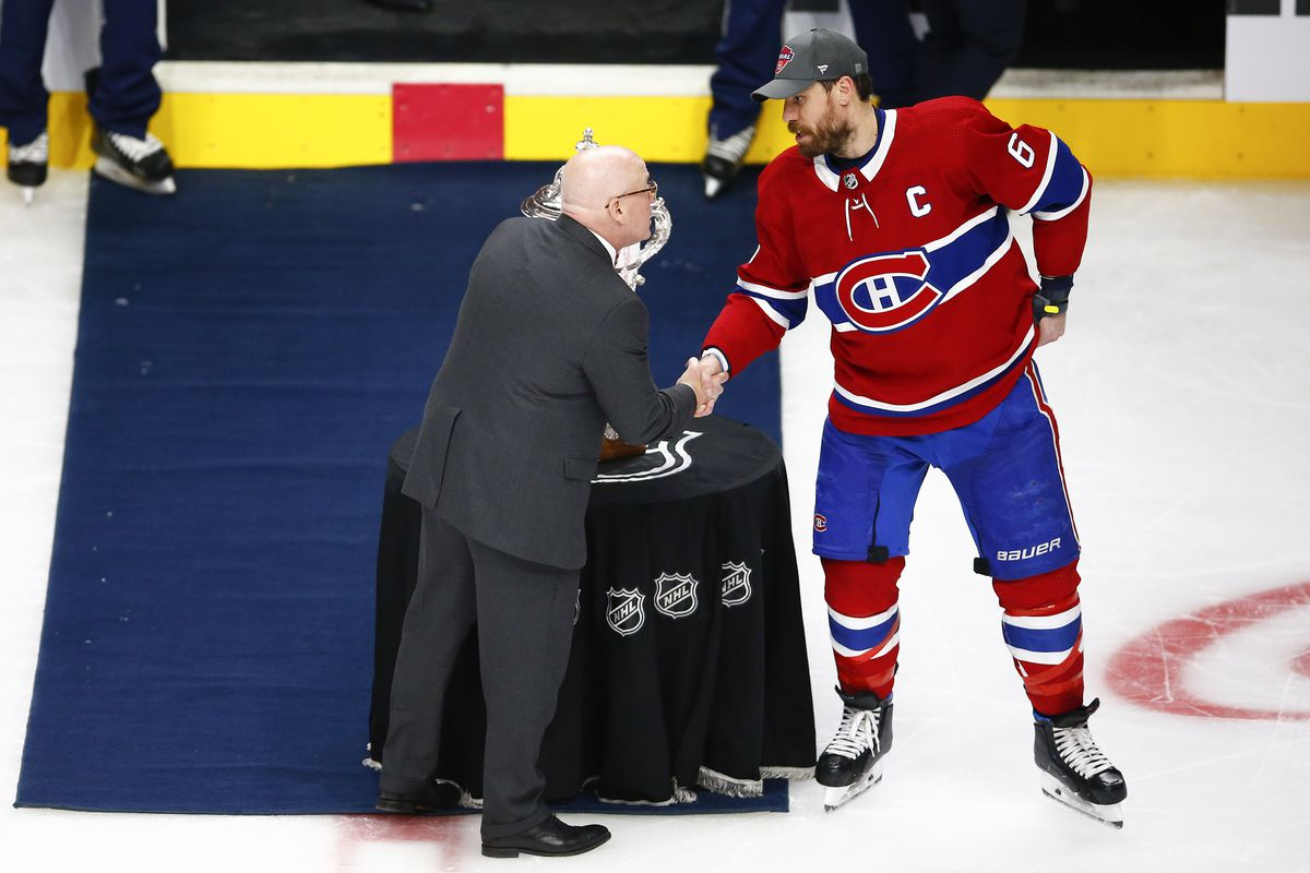 Shea Weber #6 of the Montreal Canadiens is presented the Clarence S. Campbell Bowl by deputy commissioner of the NHL Bill Daly after the team's 3-2 overtime victory against the Vegas Golden Knights in Game Six of the Stanley Cup Semifinals of the 2021 Stanley Cup Playoffs at Bell Centre on June 24, 2021 in Montreal, Quebec.