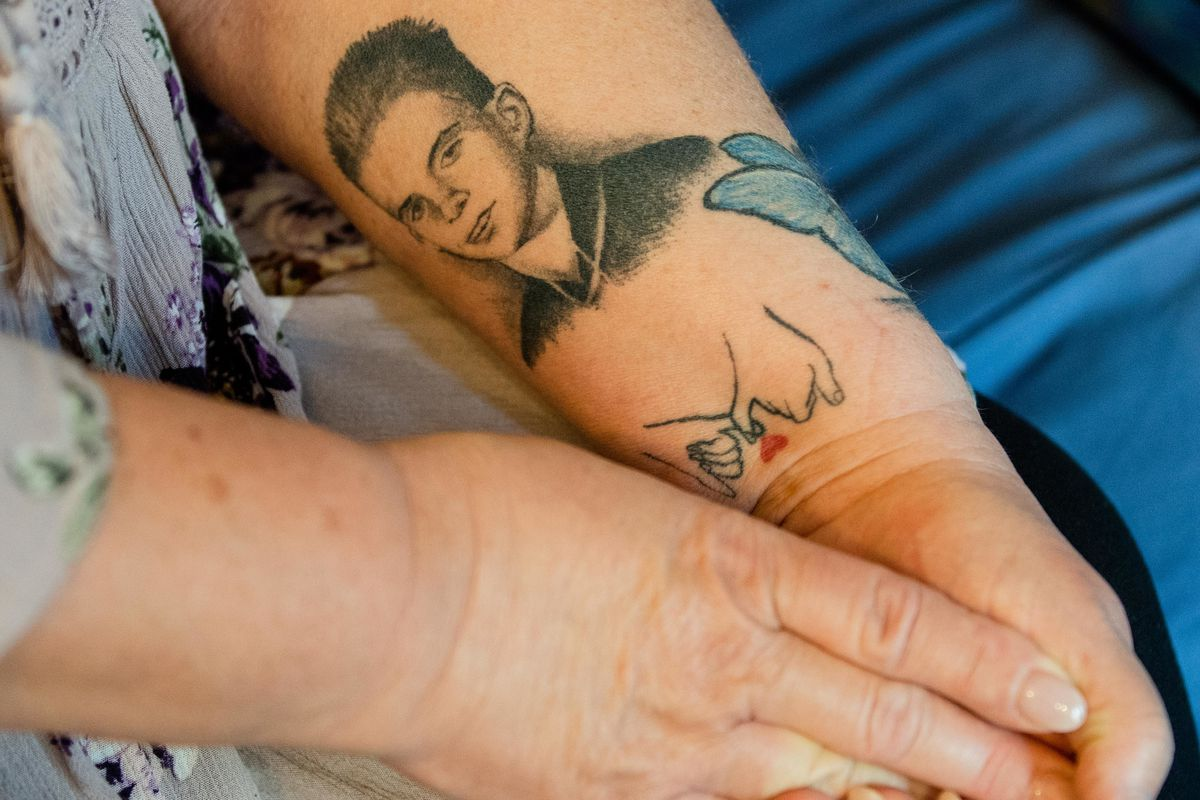 Debra Fahrforth, the mother of 12-year-old Joey Chlopek, who was shot to death by a Chicago police officer in 1992, shows a tattoo of her son at her home in Willow Springs.
