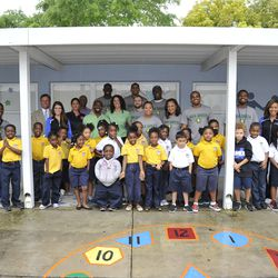 Volunteers from the Magic, OUC, and Owens Facilities Services with Nap Ford Community School students