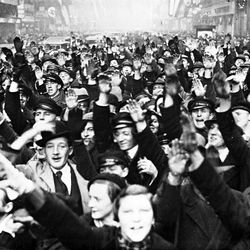 Joyous crowds give the Nazi salute in a crowded street, in Saarbrucken, Jan. 15, 1935, after the Plebiscite Commission broadcast the result of the vote to return Saarland to Germany
