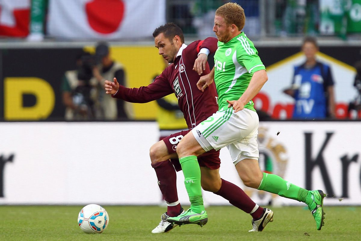 Christian Tiffert (L) of Kaiserslautern battles for the ball during the Bundesliga match between VfL Wolfsburg and 1. FC Kaiserslautern at the Volkswagen Arena on September 24, 2011 in Wolfsburg, Germany. (Photo by Martin Rose/Bongarts/Getty Images)
