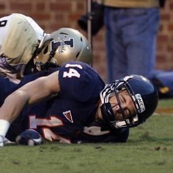 Virginia's Matt Snyder hits the turf after diving for a pass intended for him as Idaho's Gary Walker defends during an NCAA college football game Saturday, Oct. 1, 2011, in Charlottesville, Va.