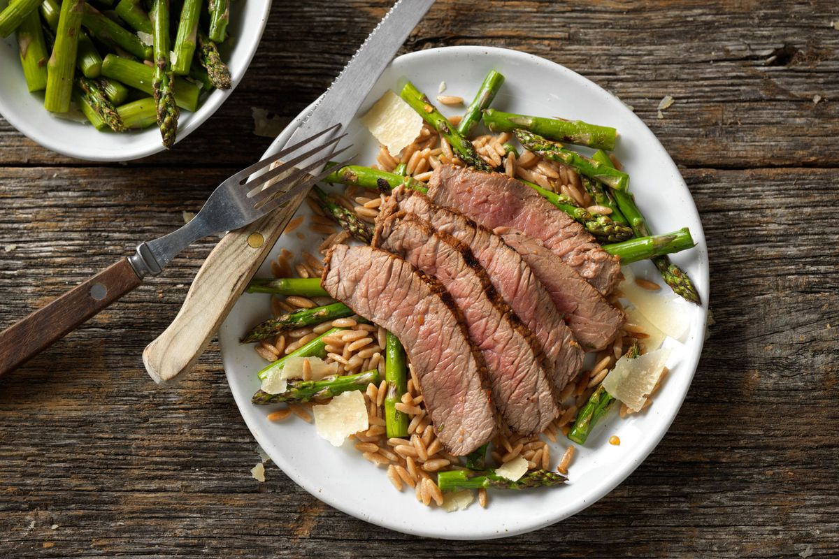Grilled top round steak with Parmesan asparagus.