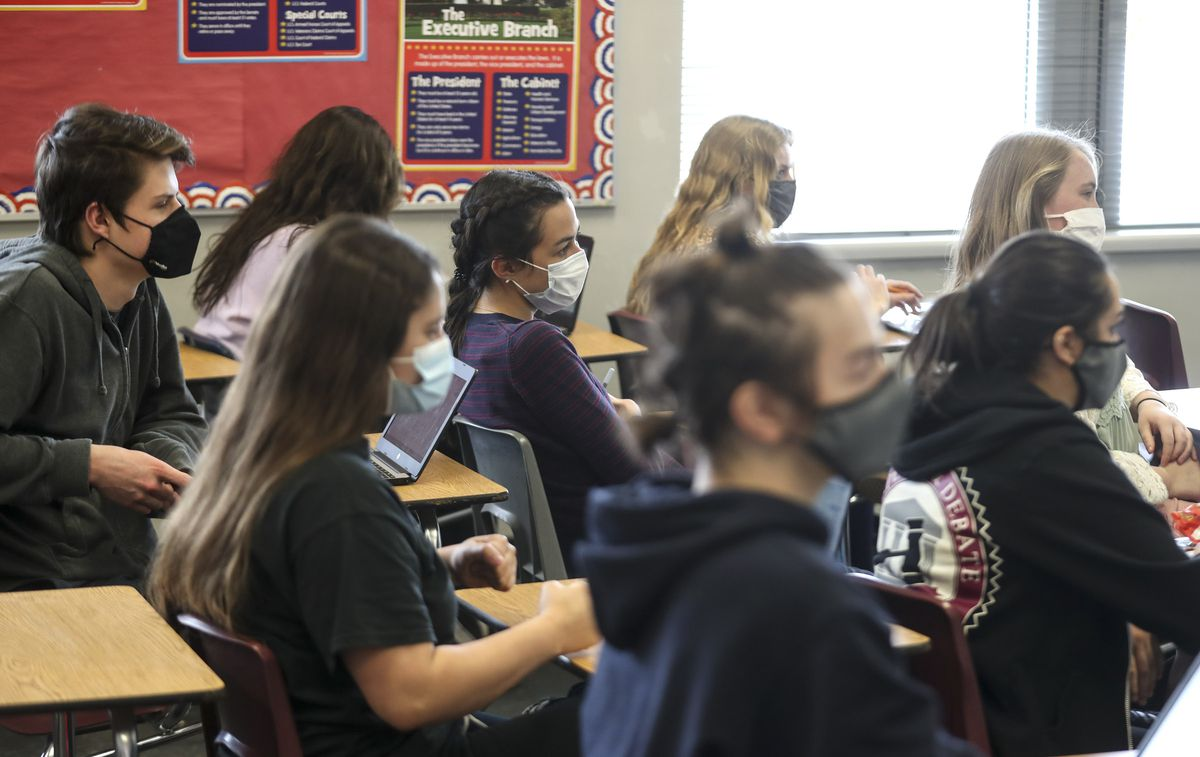 Students take notes as they attend Mallory Record's Advanced Placement government and comparative politics class at Jordan High School in Sandy on Wednesday, March 10, 2021.