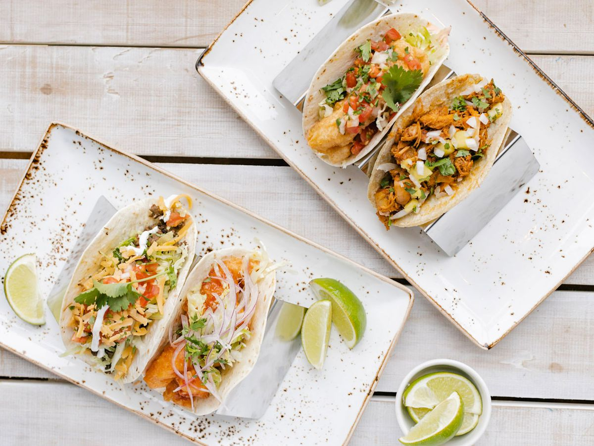 Two plates of tacos.