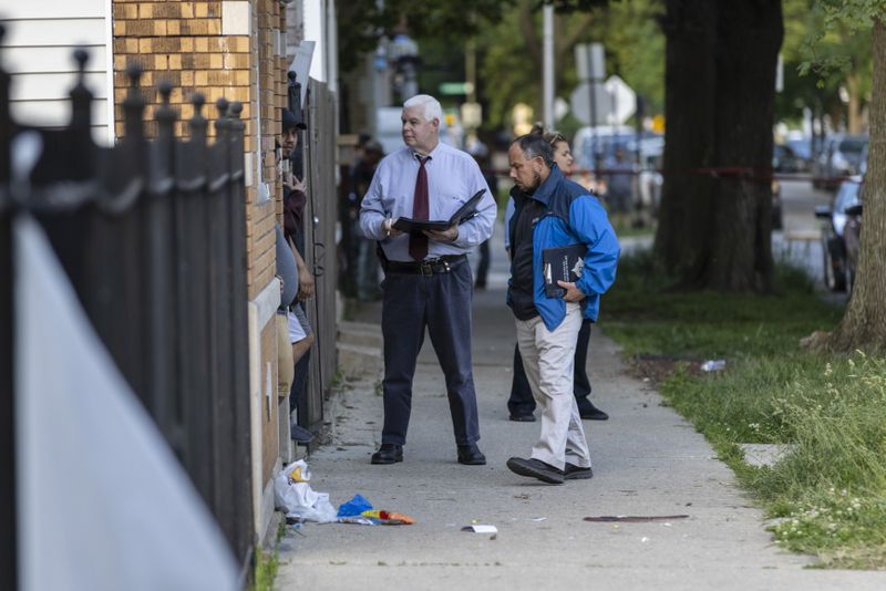 Police investigate the shooting of 14-year-old Savanah Quintero Wednesday in the 1700 block of West 48th Street in Back of Yards.