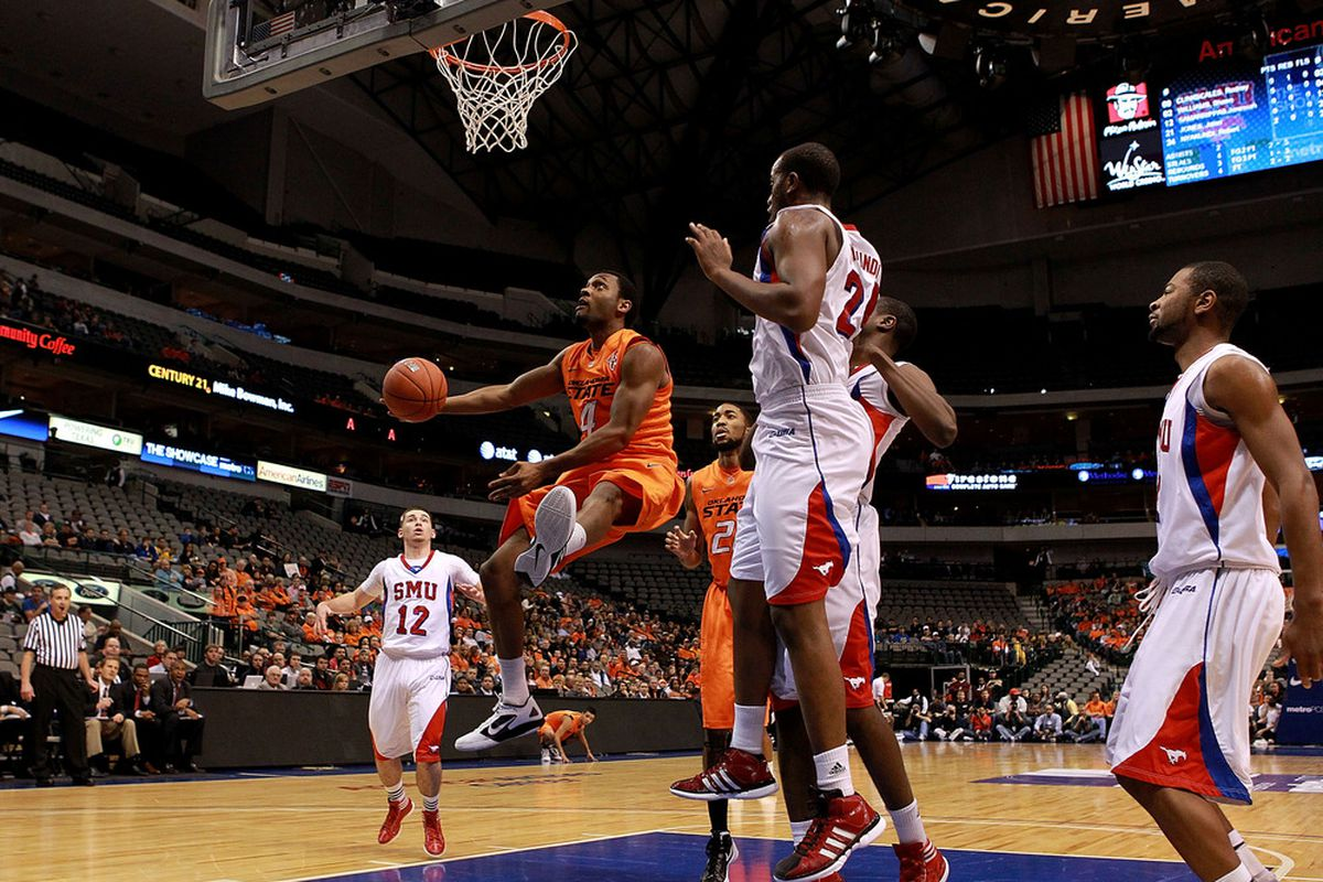Here's a picture of SMU playing a game against Oklahoma State at the American Airlines Center, which is in Dallas just like SMU is. You'll notice that 1) there's almost no one there and 2) the people who are are mostly wearing OSU orange.