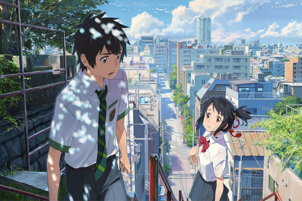 a schoolboy looks at a schoolgirl on a staircase behind him in a scene from the anime film Your Name