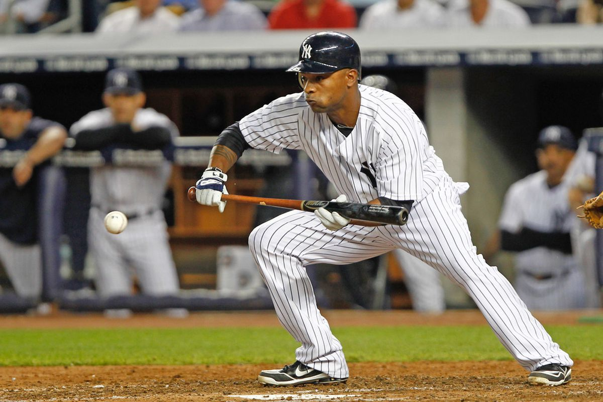 May 22, 2012; Bronx, NY, USA; New York Yankees outfielder Dewayne Wise (45) lays down a bunt against the Kansas City Royals during the fifth inning at Yankee Stadium. Mandatory Credit: Debby Wong-US PRESSWIRE