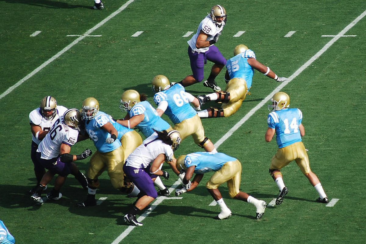 """<em>Hoping for consistent moments like this from the Bruin OL in 2010. Photo Credit: <a href=""""http://www.bruinsnation.com/2009/11/8/1113404/washington-ucla-photos"""" target=""""new"""">Telemachus</a></em>"""