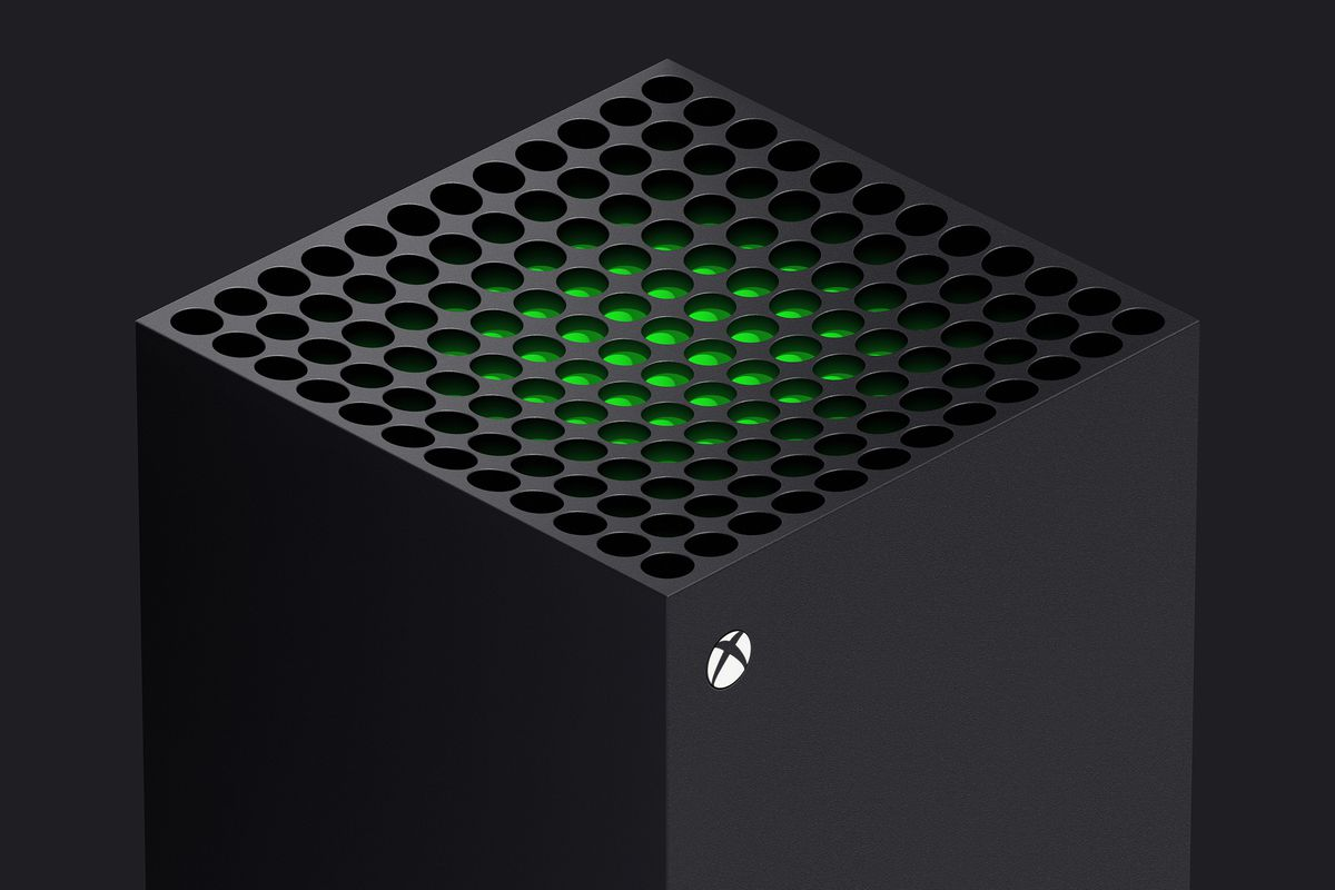 a three-quarters view of the top of the Xbox Series X, with a green piece of plastic visible just beneath the system vents