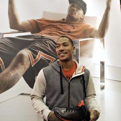 Chicago Bulls' Derrick Rose poses for photographers after unveiling his new shoe the Adidas D Rose 3 during a news conference in Chicago, Thursday, Sept. 13, 2012.