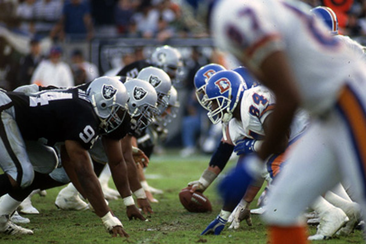 Los Angeles Raiders face off against the Denver Broncos in a playoff game January 2, 1994