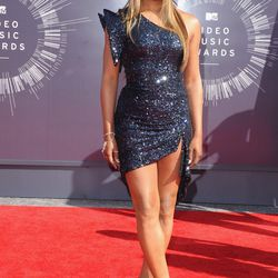 Laverne Cox wears blue tortilla chips on her right arm.