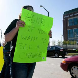 Alicia Schadrie holds a sign Tuesday, Sept. 25, 2012 on Lombardi Avenue in Green Bay, Wisc., in protest of a controversial call in the Packers 14-12 loss to the Seattle Seahawks, Monday night in Seattle. Just when it seemed that NFL coaches, players and fans couldn't get any angrier, along came a fiasco that trumped any of the complaints from the weekend. The Seahawks' victory featured one of the most bizarre finishes in recent memory, and was certain to reignite frustrations over the locked-out officials.
