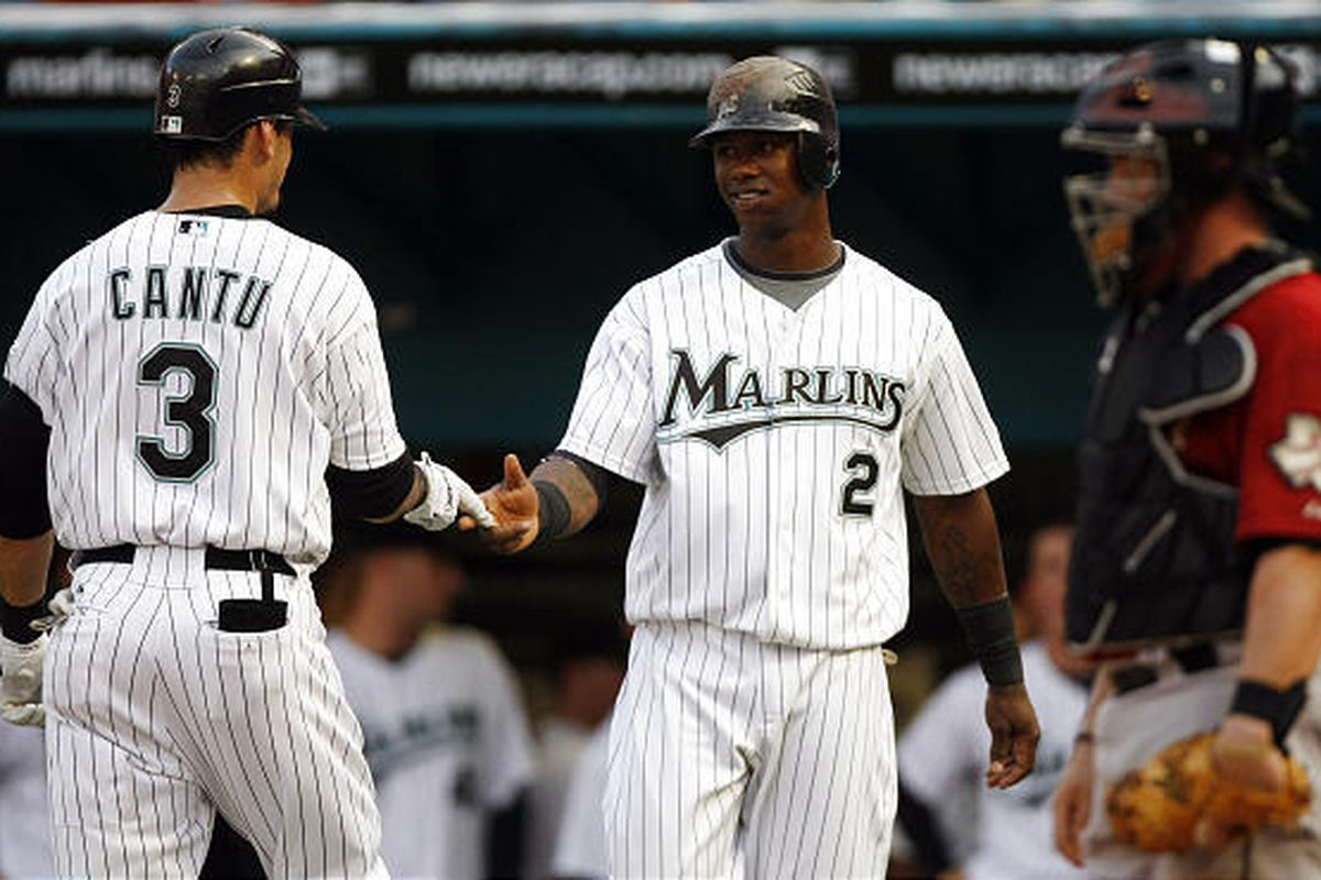 Florida Marlins' Jorge Cantu (3) is congratulated by teammate Hanley Ramirez (2) after hitting a two-run home run.
