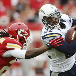 San Diego Chargers free safety Eric Weddle (32) gets past Kansas City Chiefs wide receiver Dexter McCluster (22) after an interception during the first half of an NFL football game at Arrowhead Stadium in Kansas City, Mo., Sunday, Sept. 30, 2012.