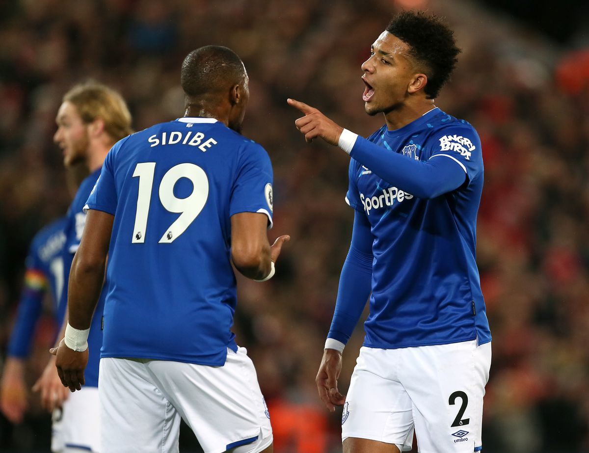 Mason Holgate (right) in discussion with team-mate Djibril Sidibe - Everton - Premier League - Anfield