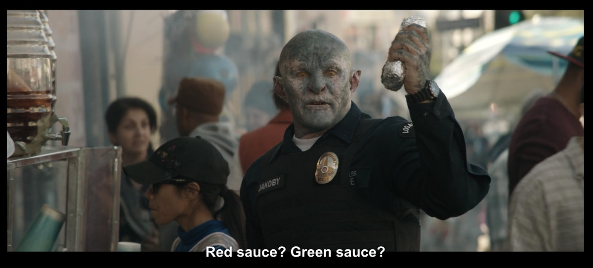 """An elf holding up a burrito with the caption, """"Red sauce? Green sauce?"""""""