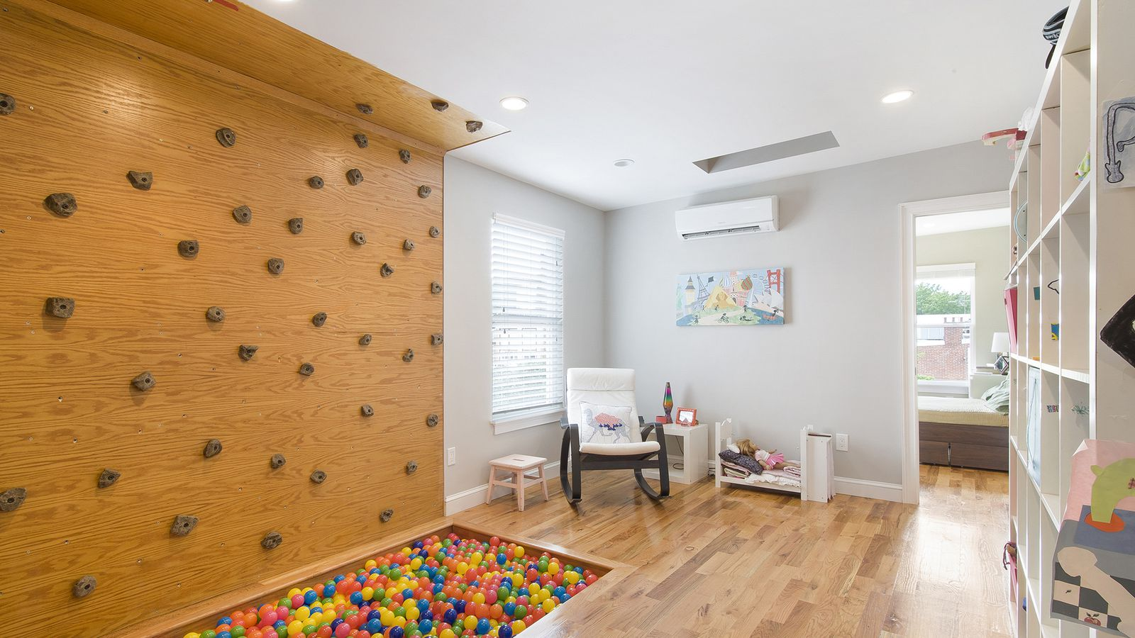 Spring garden home with ball pit rock climbing wall asks for Home climbing
