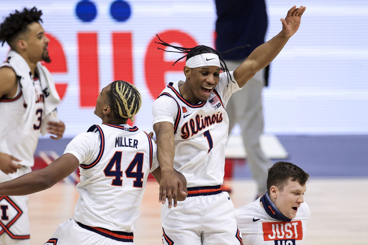 Illinois Fighting Illini guard Adam Miller and guard Trent Frazier celebrate defeating the Iowa Hawkeyes at Lucas Oil Stadium.
