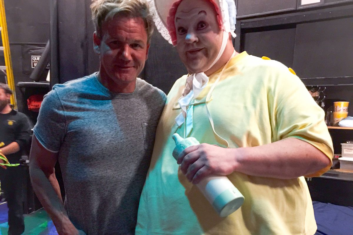 Gordon Ramsay poses with the famous gigantic baby from Mystere by Cirque du Soleil.