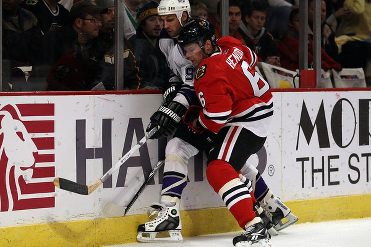 CHICAGO - OCTOBER 27: Jordan Hendry #6 of the Chicago Blackhawks battles for the puck along the boards with Ryan Smyth #94 of the Los Angeles Kings at the United Center on October 27 2010 in Chicago Illinois. (Photo by Jonathan Daniel/Getty Images)