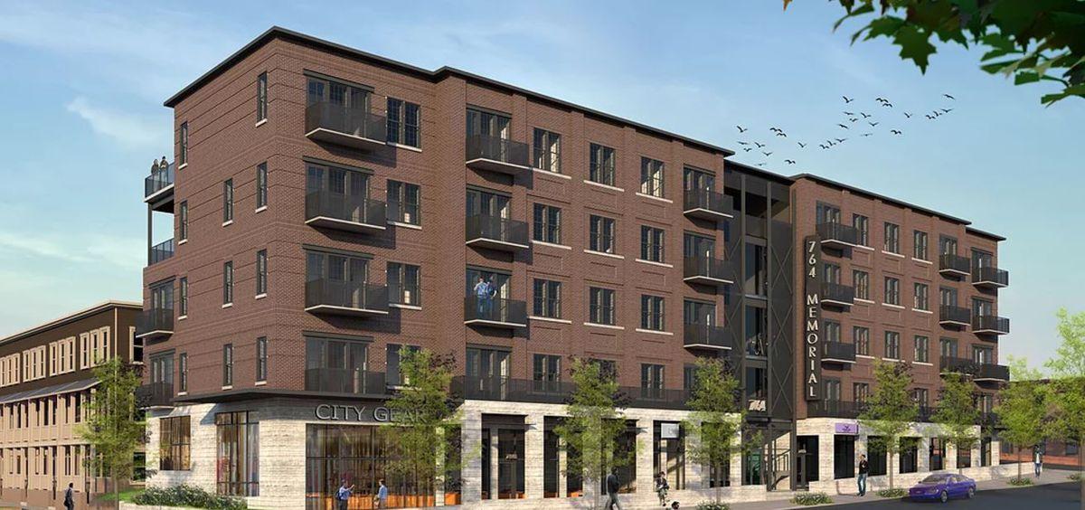 Four stories of brick-clad residences, atop a podium of retail.