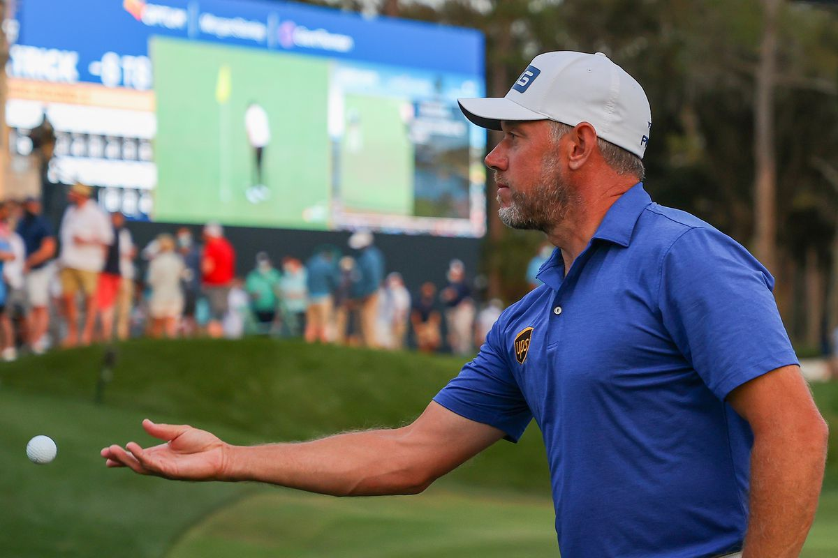 Lee Westwood of England tosses his ball to a fan after finishing on the 18th green during the third round of THE PLAYERS Championship on THE PLAYERS Stadium Course at TPC Sawgrass on March 13, 2021 in Ponte Vedra Beach, Florida.