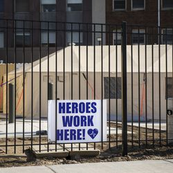 """A """"Heroes Work Here"""" sign outside the tent and triage area for coronavirus testing at Mount Sinai Hospital, 1500 S. Fairfield Ave."""