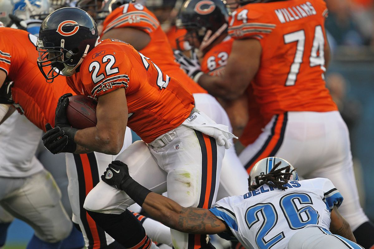 CHICAGO, IL - NOVEMBER 13: Matt Forte #22 of the Chicago Bears runs past Louis Delmas #26 of the Detroit Lions for a touchdown at Soldier Field on November 13, 2011 in Chicago, Illinois. (Photo by Jonathan Daniel/Getty Images)