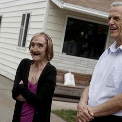 Mandi Shaw and Ron Baker stand outside Shaw's home in Kearns on Wednesday, April 18, 2012.