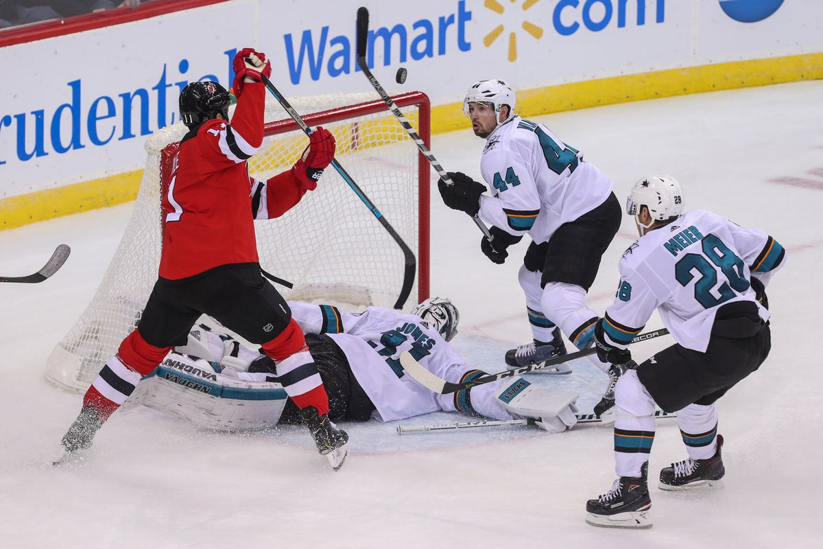 Oct 14, 2018; Newark, NJ, USA; New Jersey Devils center Brian Boyle (11) and San Jose Sharks defenseman Marc-Edouard Vlasic (44) look for the puck after a save by San Jose Sharks goaltender Martin Jones (31) during the third period at Prudential Center.