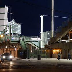View of the ballpark lights on, along Waveland Avenue