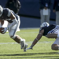 Brigham Young Cougars linebacker Isaiah Kaufusi (53) scoops up a North Alabama fumble during a game in Provo on Saturday, Nov. 21, 2020.