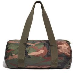 """Camo for the drill sergeant in you. <a href=""""https://www.madewell.com/madewell_category/BAGS/duffels/PRDOVR~05276/05276.jsp"""">Herschel Packable Duffle</a>, $30 at Madewell."""