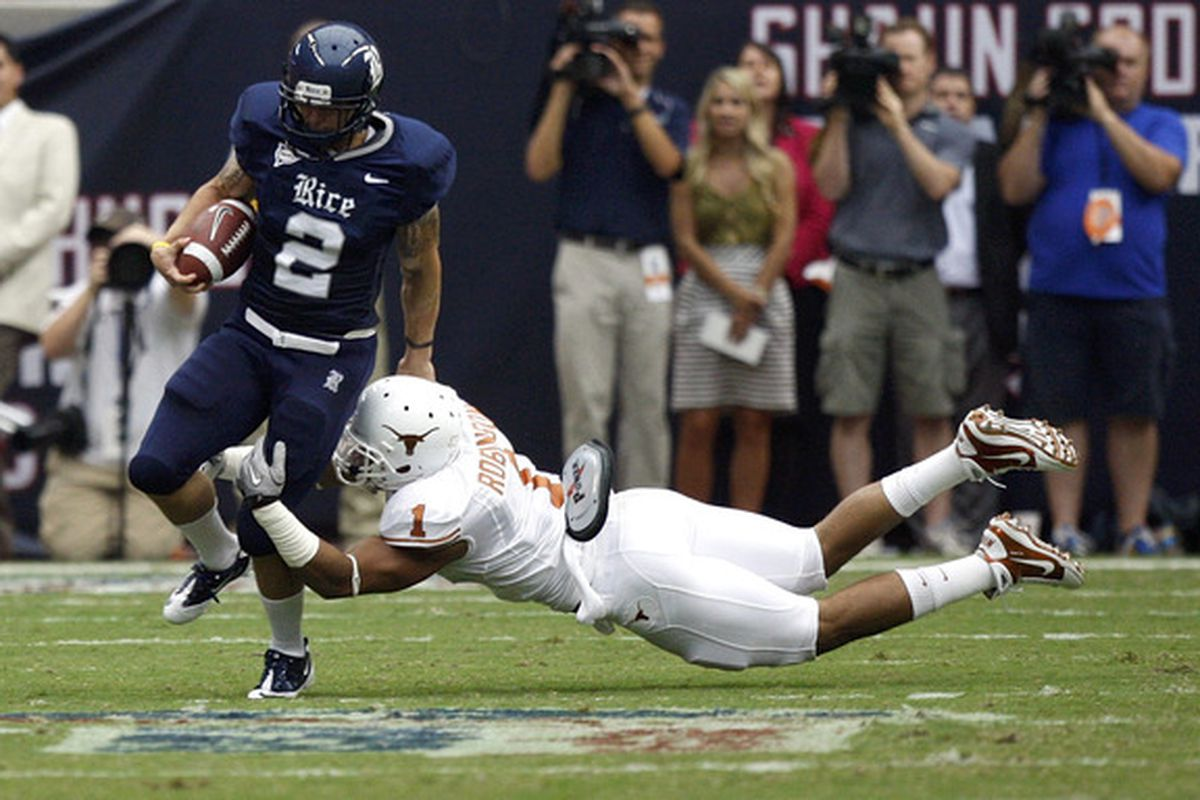 HOUSTON - SEPTEMBER 04:  Running back Sam McGuffie #2 of the Rice Owls is tackled by linebacker Keenan Robinson #1 of the Texas Longhorns at Reliant Stadium on September 4 2010 in Houston Texas.  (Photo by Bob Levey/Getty Images)