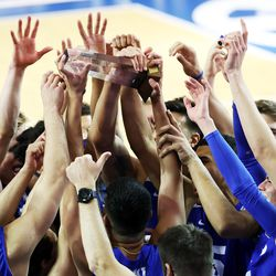 BYU players hold up the winning trophy after defeating Pepperdine in the finals of the Mountain Pacific Sports Federation Championship, at the Smith Field House in Provo on Saturday, April 24, 2021. BYU won in straight sets.