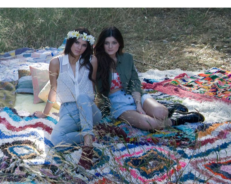 """Kendall and Kylie Jenner pose at photo shoot in 2012 wearing items from their new fashion line """"Kendall and Kylie"""" available exclusively at PacSun."""
