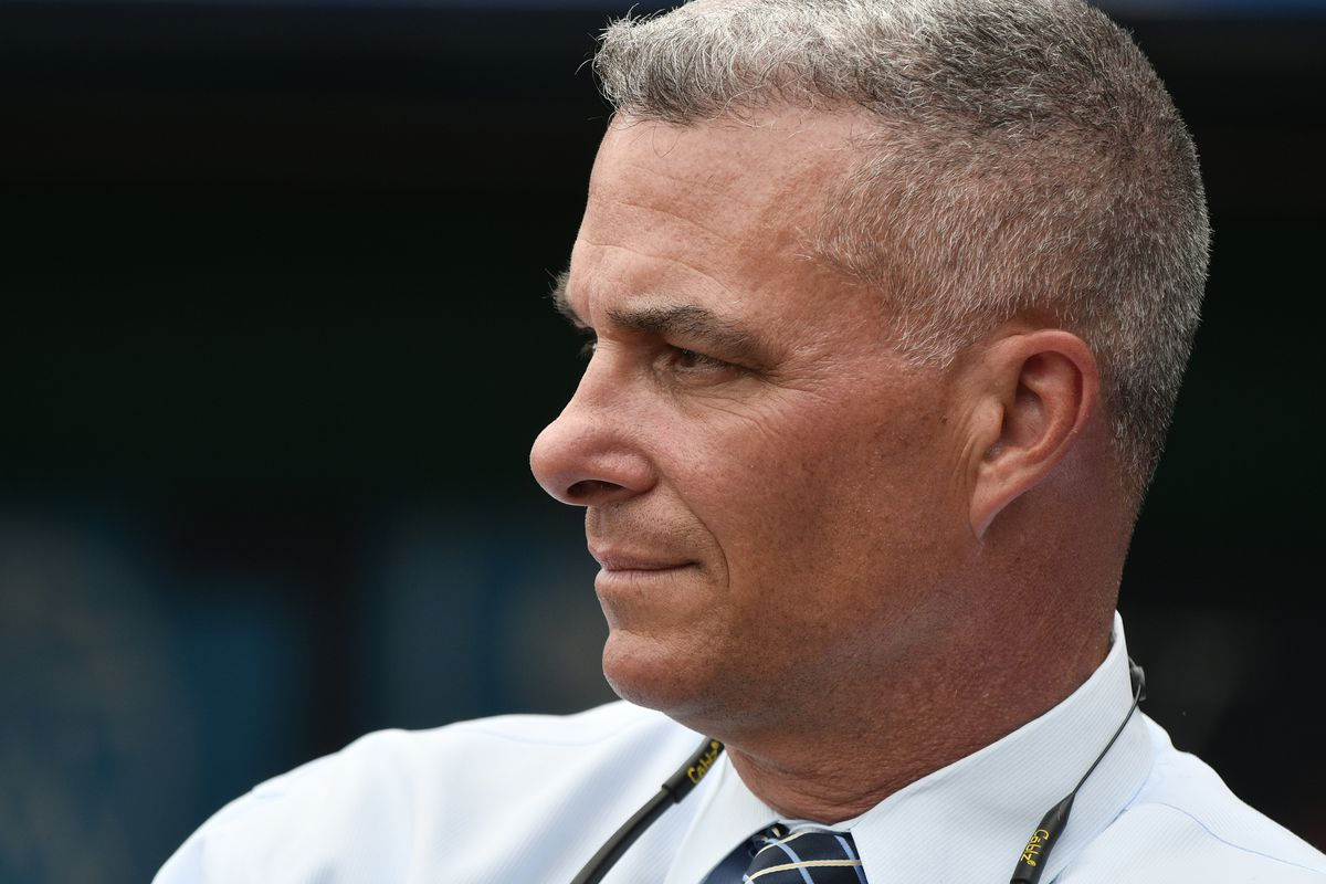 Dayton Moore general manager of the Kansas City Royals watches batting practice prior to a game against the Cincinnati Reds at Kauffman Stadium on June 12, 2018 in Kansas City, Missouri.